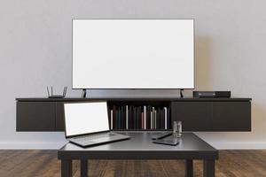 Maqueta de televisión y computadora portátil en una sala de estar con libros y una mesa pequeña, representación 3D foto