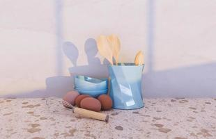 Kitchen accessories with eggs and window illuminating the scene, 3d rendering photo