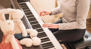 Caucasian woman playing piano