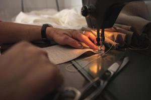 Woman doing sewing photo