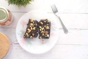 Brownies with nuts on a plate photo