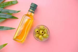 Flat lay of olives and olive oil photo
