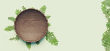 Dark wooden plate with pine leaves underneath, 3d rendering