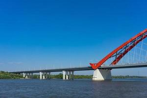 Bugrinsky Bridge across the Ob River with a clear blue sky in Novosibirsk, Russia photo