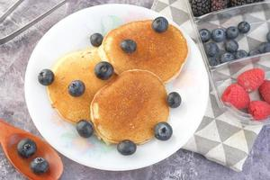 Top view of berries and pancakes