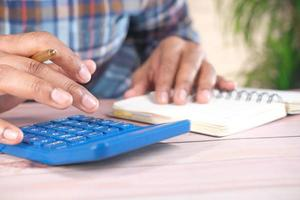 Close-up of a man hand using a calculator