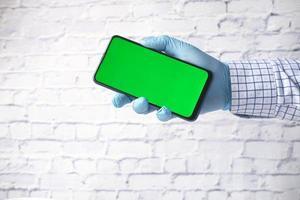 Gloved hand holding smartphone mock-up