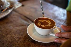 Person making latte art photo