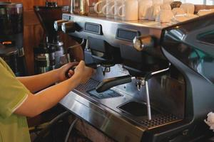 Person using an espresso machine