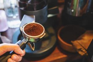 Ground espresso in tamper photo