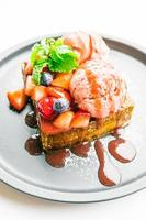Sweet dessert with honey toast with strawberry and jam photo