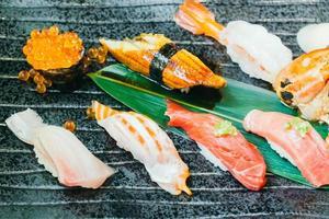 Raw and fresh salmon tuna shrimp and other sushi photo