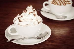 Hot marshmallow chocolate in white cup photo