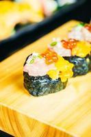 Uni sushi with otoro tuna and salmon egg on top photo