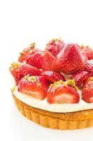 Sweet dessert with strawberry on top of tart photo
