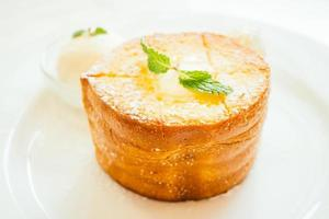 French toast bread with butter on top and ice cream photo