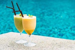Smoothies with pool background photo