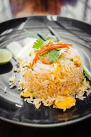 Fried rice with prawn on top photo