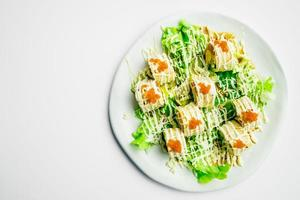 Sushi roll with tuna salmon and sweet egg inside photo