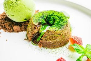 Green tea chocolate lava with ice cream and strawberry photo