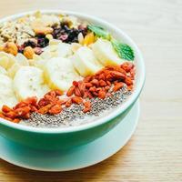 Mixed fruit with muesli and granola photo