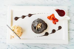 Sweet dessert with chocolate lava cake and ice cream photo