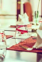 Selective focus point on glass in restaurant photo