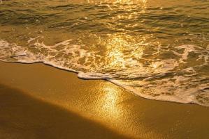 Sea water and sun flare photo