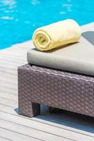 Towels on the bed at the pool photo