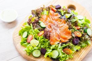 Raw Smoked salmon meat fish with fresh green vegetable salad