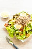 Tuna meat and eggs with fresh vegetable salad photo