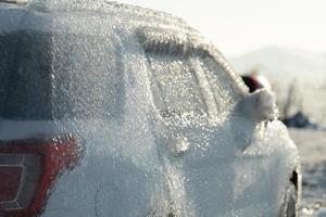 A car covered in ice in Vladivostok, Russia photo