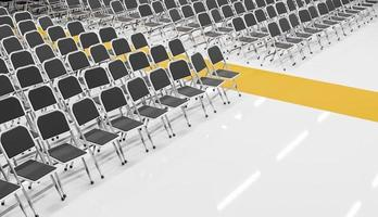 Room full of folding chairs with a yellow carpet photo