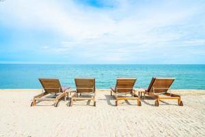 Sunbathing beds on a tropical beach photo