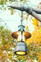 Old lantern with outdoor view in autum season