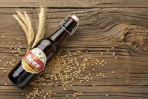 Beer with barley on wood background