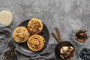 Top view cinnamon roll and sticks photo
