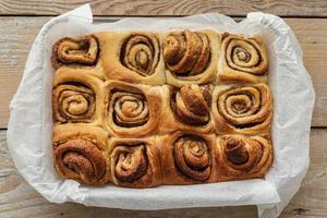 Top view cinnamon rolls on tray photo