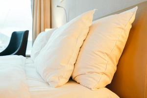 White pillows on the bed photo