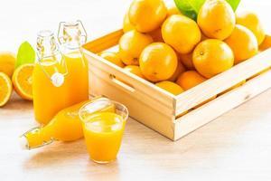 Fresh orange juice for drink in bottle glass photo