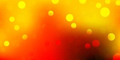 Light red, yellow vector background with spots.