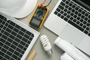 Electrical device on desk with laptop photo