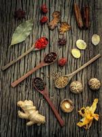 Ingredients for Chinese herbal soup on shabby wooden background photo