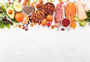 Ingredients for healthy foods selection on white wooden background photo