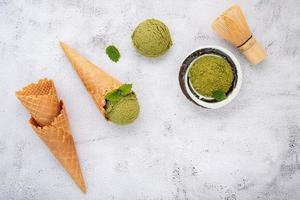 Matcha green tea ice cream with waffle cone and mint leaves