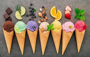 Flat lay ice cream cones collection on dark stone background photo
