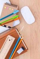 Back to school concept with school supplies on wooden table