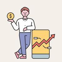 un hombre está apoyado en un móvil y sostiene una moneda en una mano. el gráfico ascendente está subiendo en la pantalla del móvil. Ilustración de vector mínimo de estilo de diseño plano.