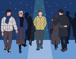 A man walking alone in a snowy night among couples. hand drawn style vector design illustrations.