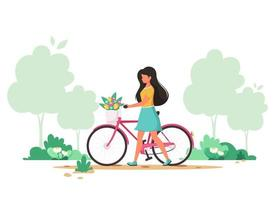 Woman with a bike with flowers in the basket. Springtime. Vector illustration.